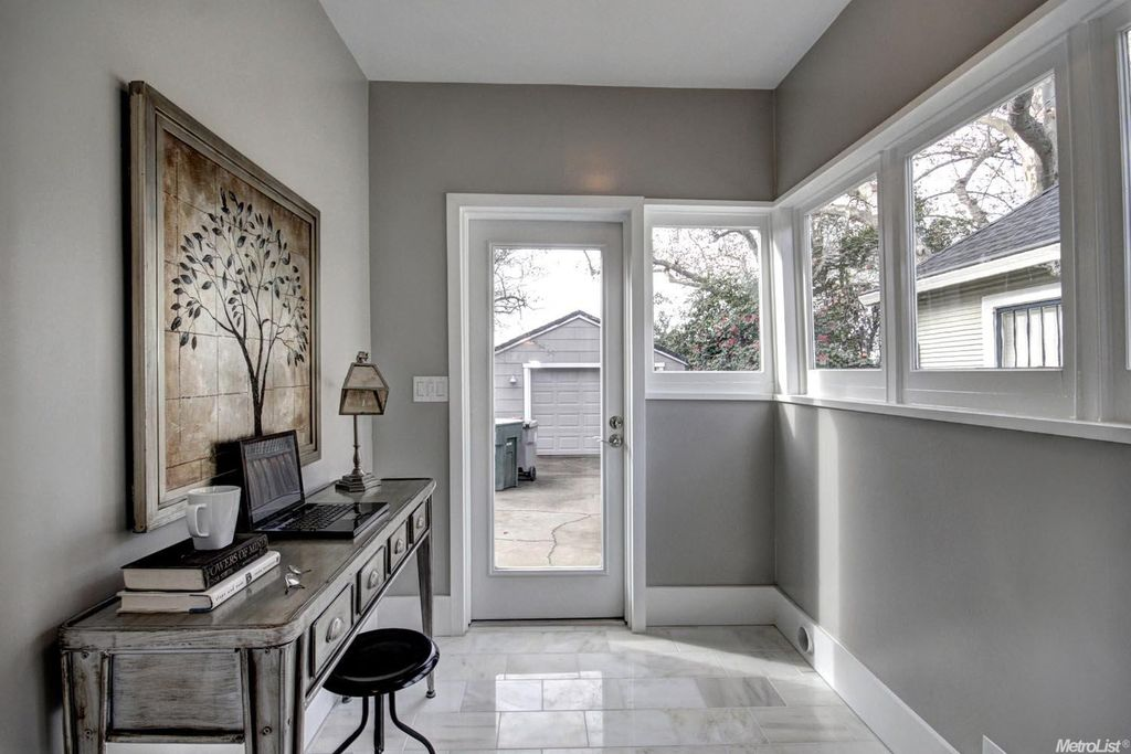 Transitional Home Office home office with limestone tile floors & high ceiling in