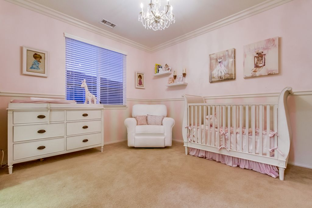 Traditional Nursery With High Ceiling Chandelier Crown Molding Carpet Chair Rail
