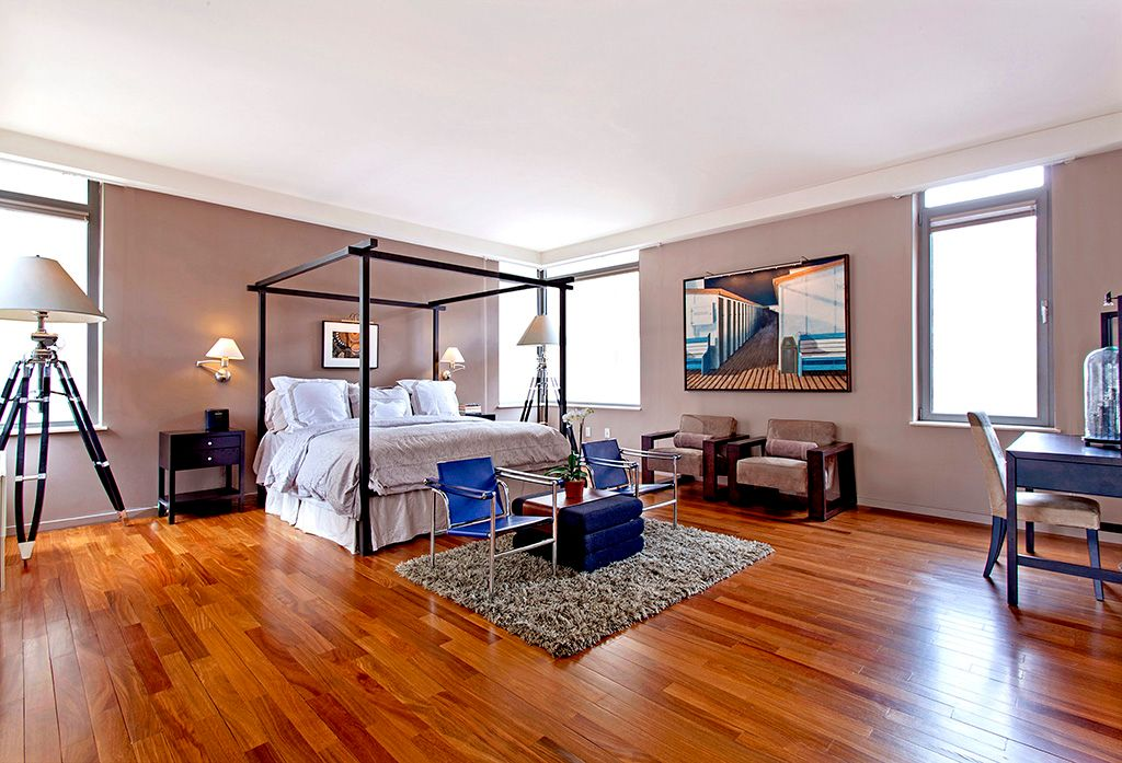contemporary master bedroom with hardwood floorsthe corcoran