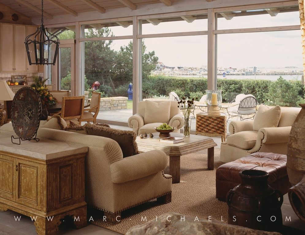 traditional living room with exposed beammarcmichaels