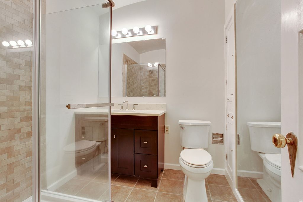 Bathroom Cabinets New Orleans traditional 3/4 bathroom with european cabinets & flush in new