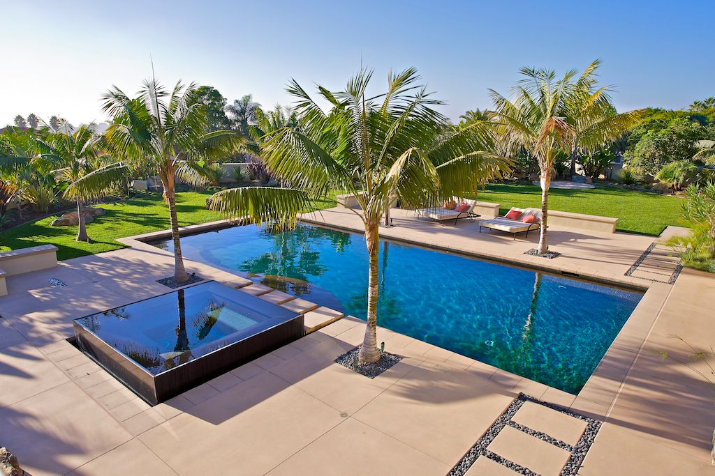 Contemporary Swimming Pool with Fence, Lap pool, exterior tile floors,  Pathway