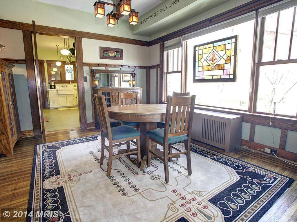 craftsman dining room with hardwood floors & chandelier in