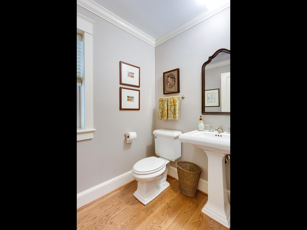 traditional powder room with specialty door american standard town square 24 inch pedestal sinks