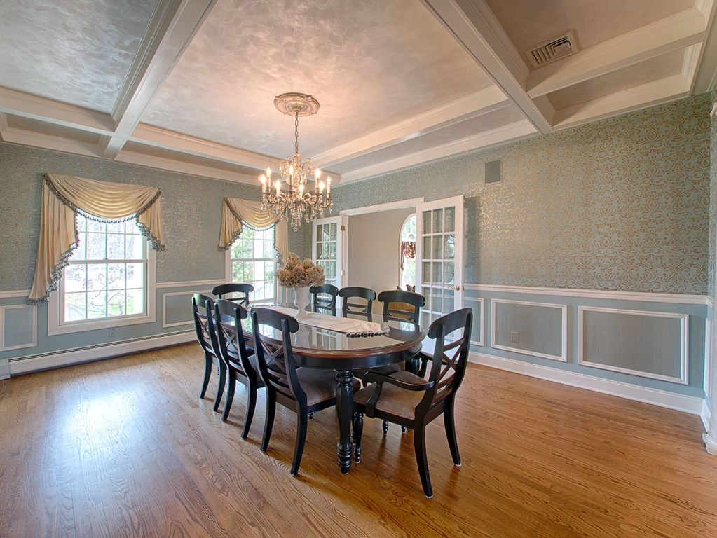 traditional dining room with high ceiling & wainscoting | zillow