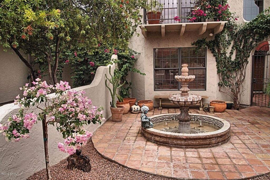 Mediterranean Patio With Arbor, Fence, Exterior Tile Floors, Gate, Cast  Stone Grande