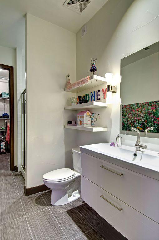 Corian Bathroom Vanity contemporary 3/4 bathroom with flushfinished basement | zillow