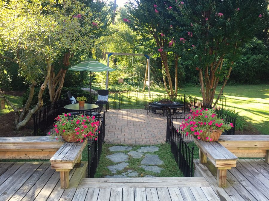 Traditional landscape and yard with bird bath pathway in for Landscaping rocks greensboro nc