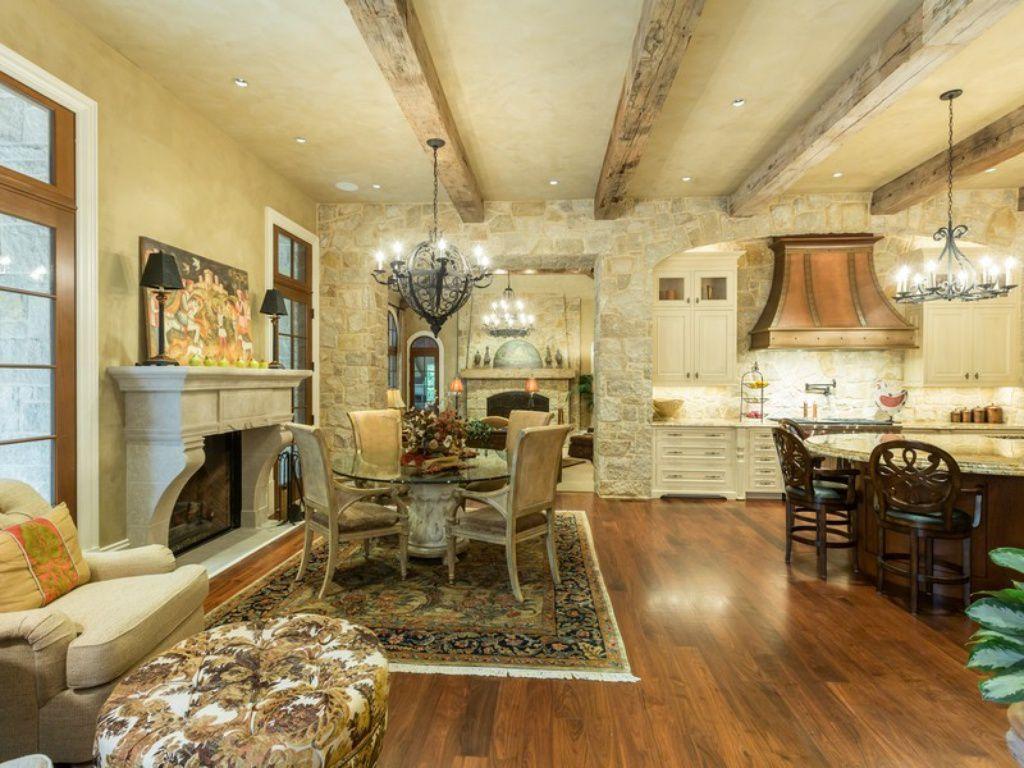 mediterranean dining room with custom hood & complex granite