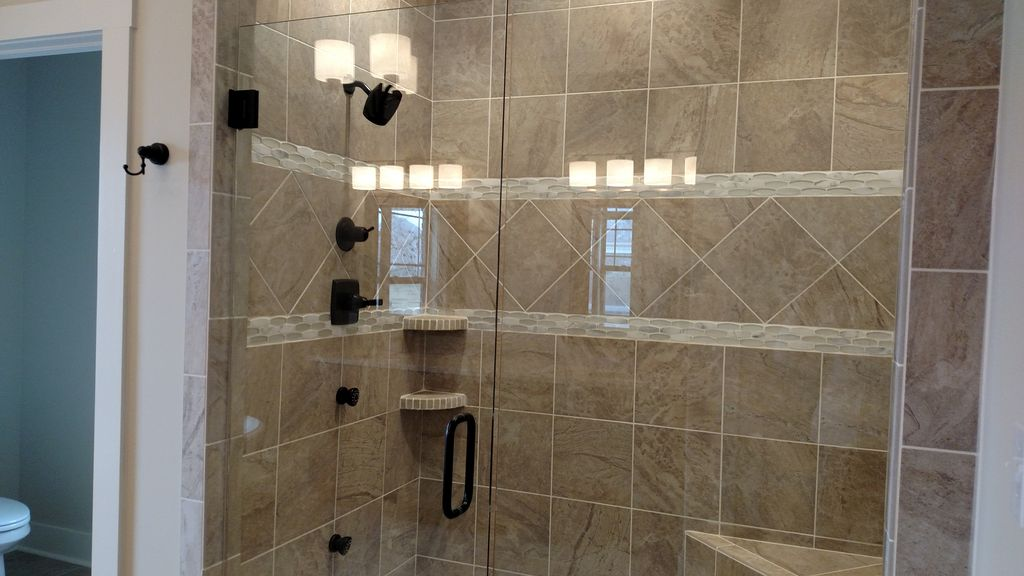 Traditional Master Bathroom with Rain Shower Head & specialty tile ...