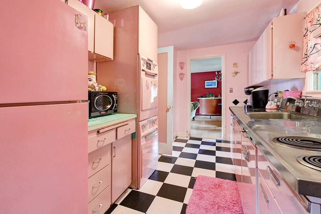 Elegant 2 Tags Eclectic Kitchen With Formica Counters, European Cabinets, Stainless  Steel Counters, Flush Light,