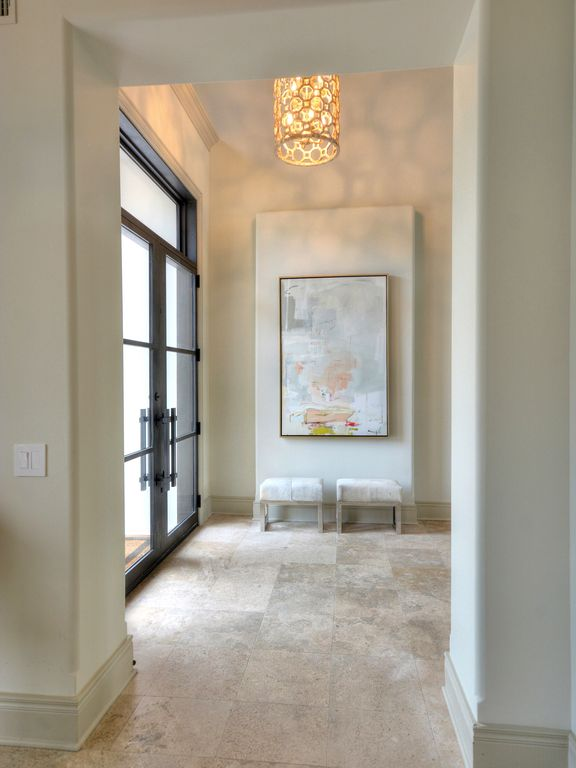 Modern Foyer Tile : Modern entryway with limestone tile floors pendant light