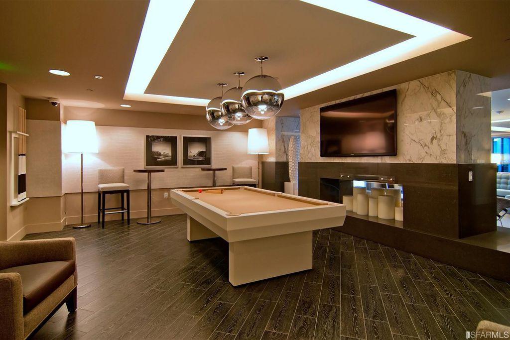 Modern Game Room With Pendant Light Mirror Ball Hardwood Floors High