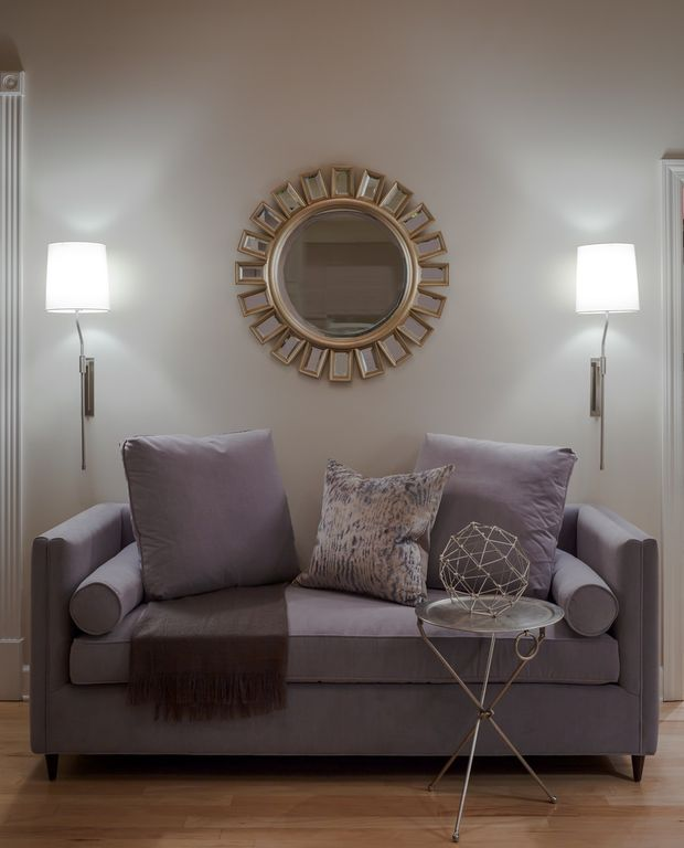 Contemporary Living Room With Hardwood Floors, Cyrus Round Mirror, Wall  Sconce, Collapsible Cocktail