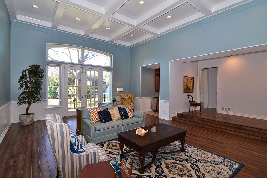 Traditional Living Room With High Ceiling Sunken Carpet Wainscoting Hardwood