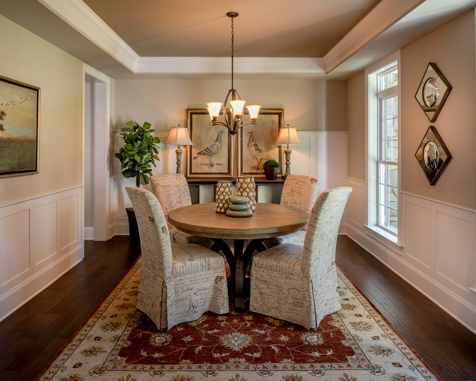 traditional dining room with carpetcustomhomegroup | zillow