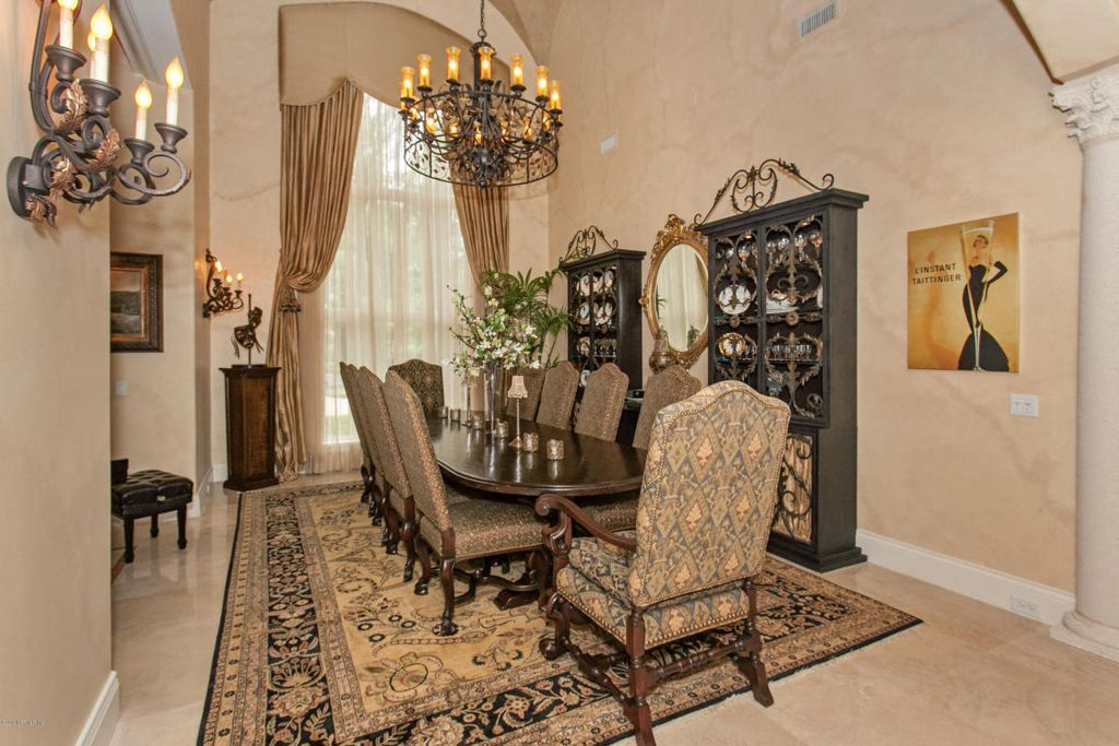 Mediterranean Dining Room With Wall Sconce Chandelier Carpet Cathedral Ceiling Limestone Tile