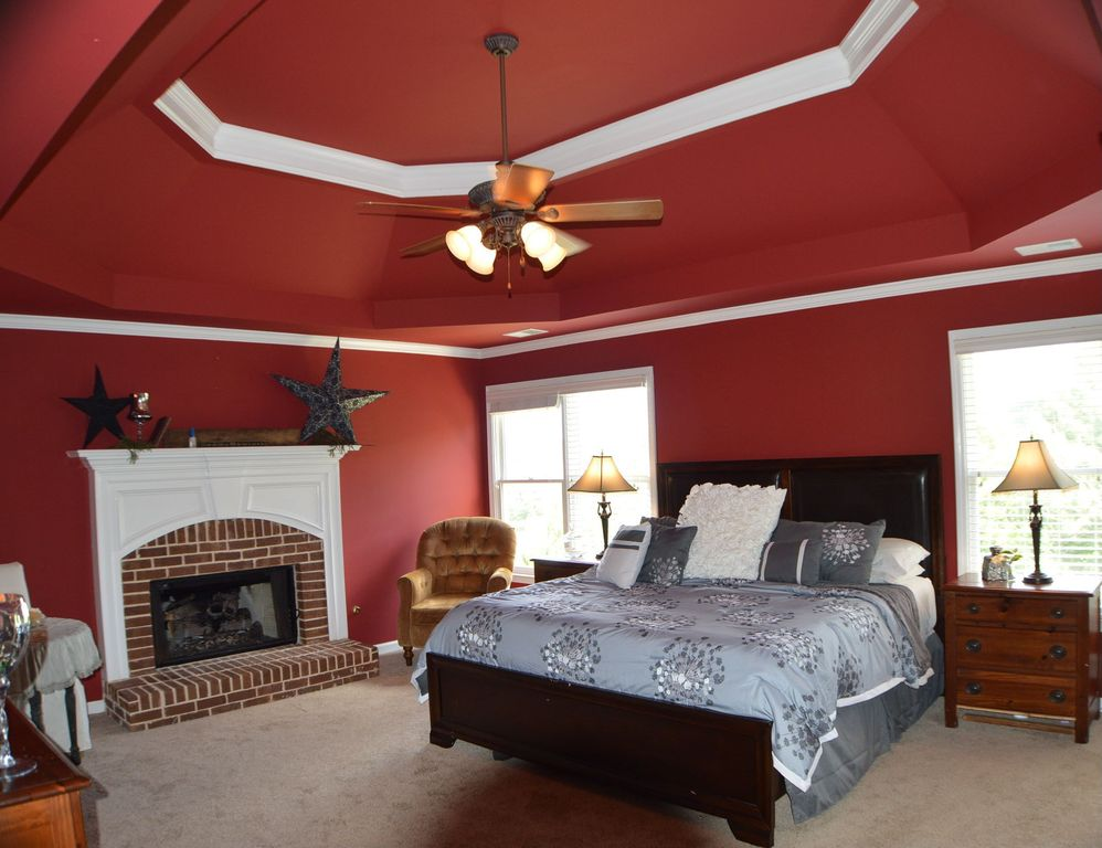 2 Tags Traditional Master Bedroom With Projecting Fireplace, Crown Molding,  Coved Ceiling, Table Lamp,