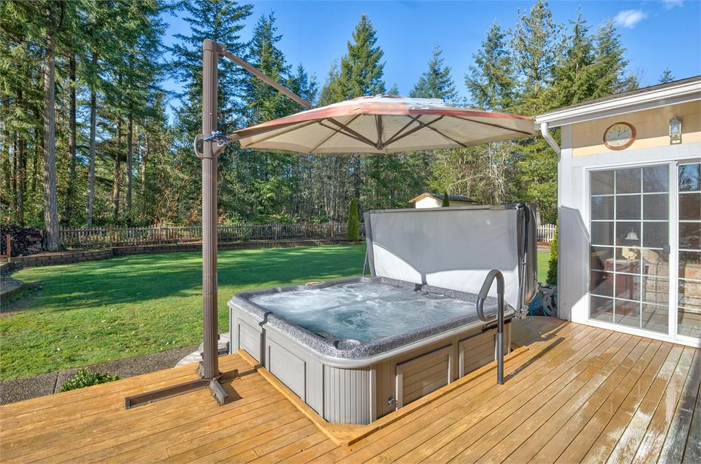traditional deck with jacuzzi hot tub pathway exterior stone floors raised beds