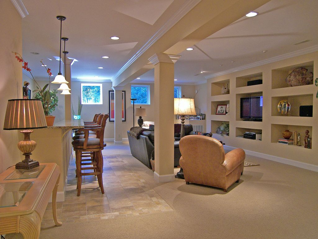 Basement with pendant light travertine tile floors in cincinnati transitional basement with exposed beam columns travertine tile floors crown molding pendant dailygadgetfo Images