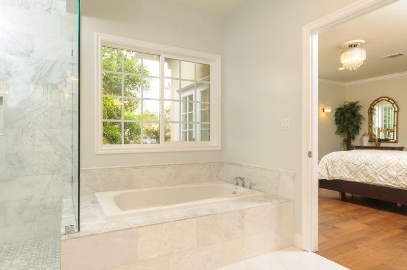 Master Bathroom Natural Stone master bathroom with drop-in bathtub & master bathroom in la