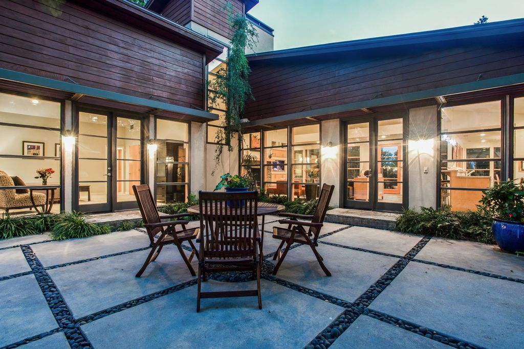 Contemporary Patio With Exterior Stone Floors, Wrap Around Porch, Classic  Dining Set By Anderson