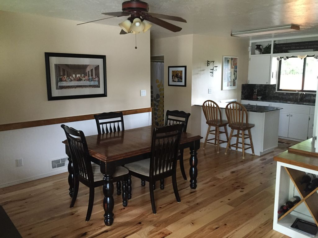 Traditional Dining Room With The Last Supper Framed Painting Print, Chair  Rail, Hardwood Floors