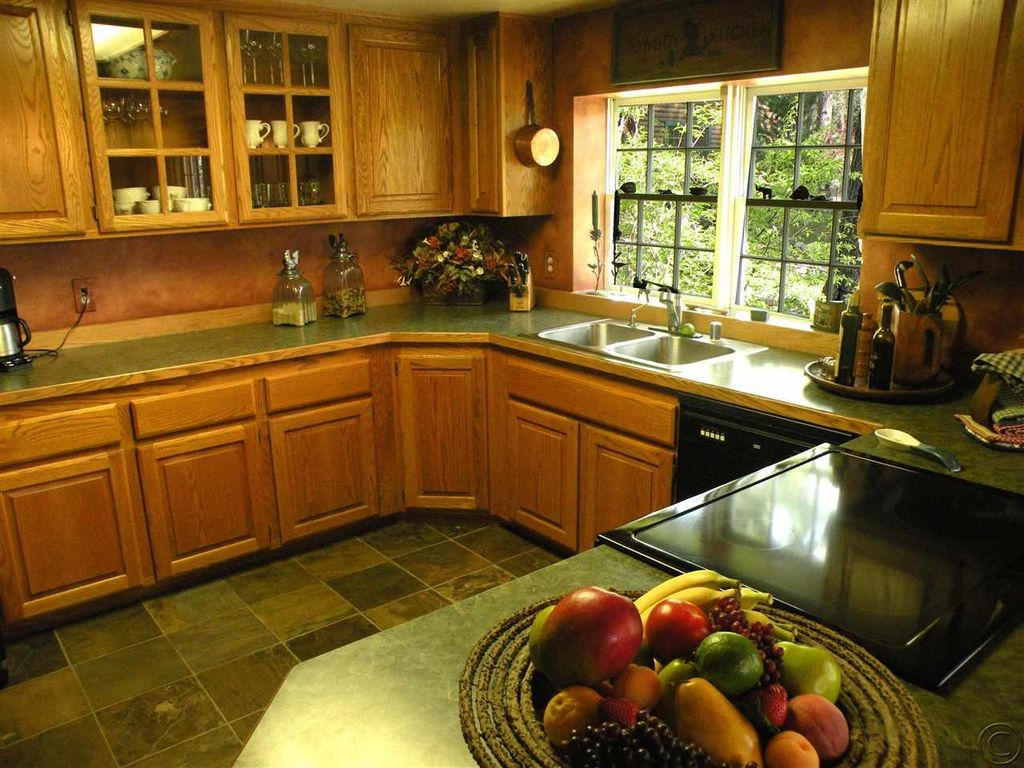 Country Kitchen International Country Kitchen With U Shaped Complex Granite Counters In