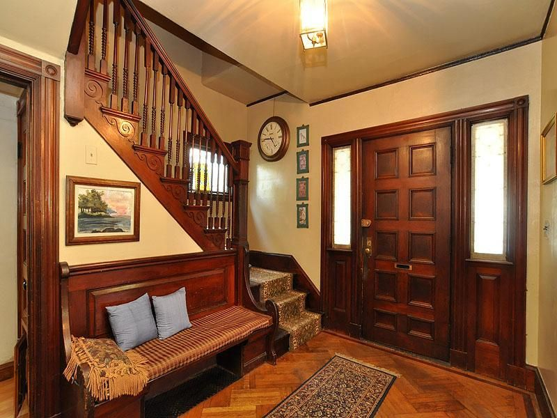 Craftsman entryway with hardwood floors flush light for Victorian house interior designs