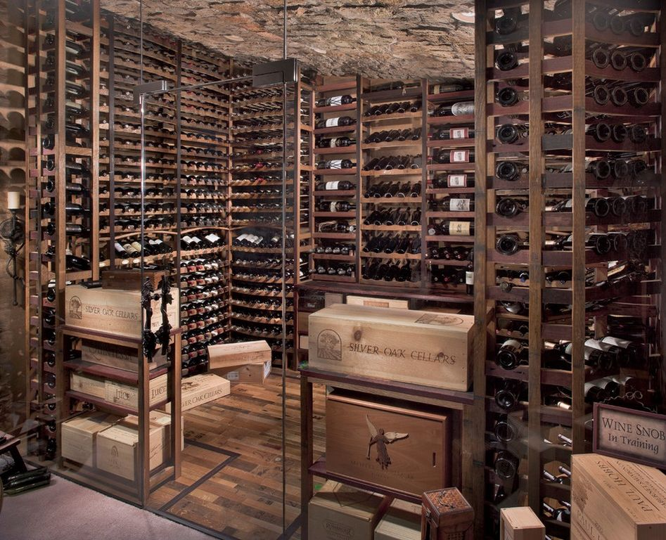 Contemporary wine cellar with specialty door by wine Cellar designs