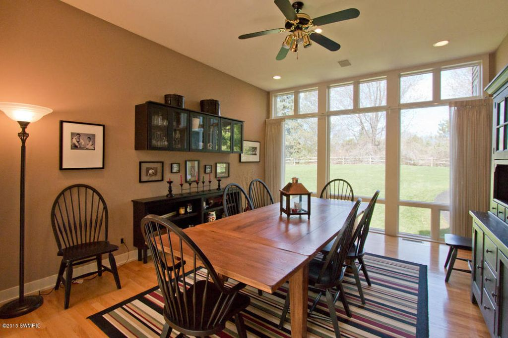 Country Dining Room With Built In Bookshelf, Flush Light, High Ceiling,  Carpet