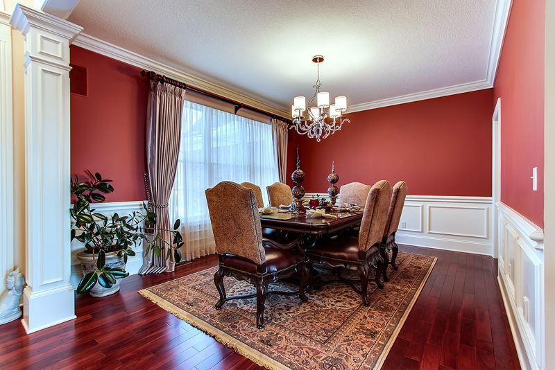 Dining Room With Wainscoting Hardwood Floors In Bettendorf Ia