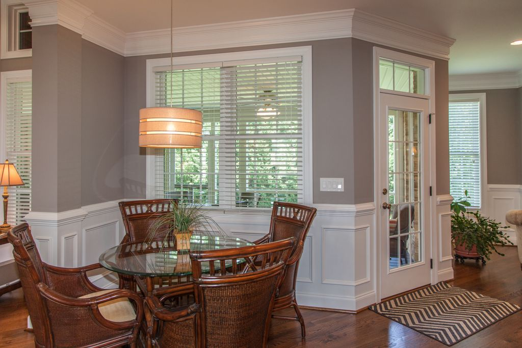 Traditional Dining Room With Crown Molding Hardwood Floors French Doors Pendant Light