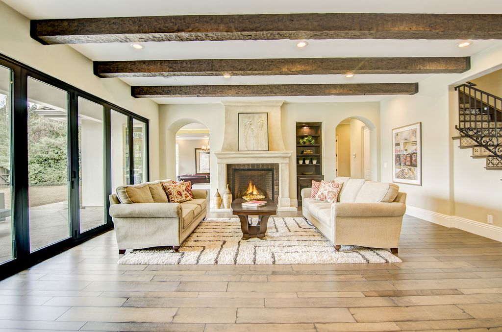 Traditional Living Room With High Ceiling, Exposed Beam, Hardwood Floors,  Carpet, Rough