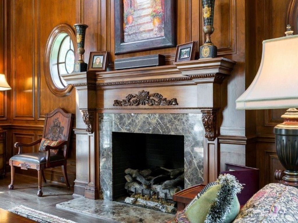 craftsman living room with stone fireplace & chair rail | zillow