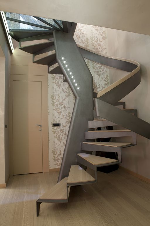 Contemporary Staircase with Spiral staircase, High ceiling, interior  wallpaper, Hardwood floors, Floating