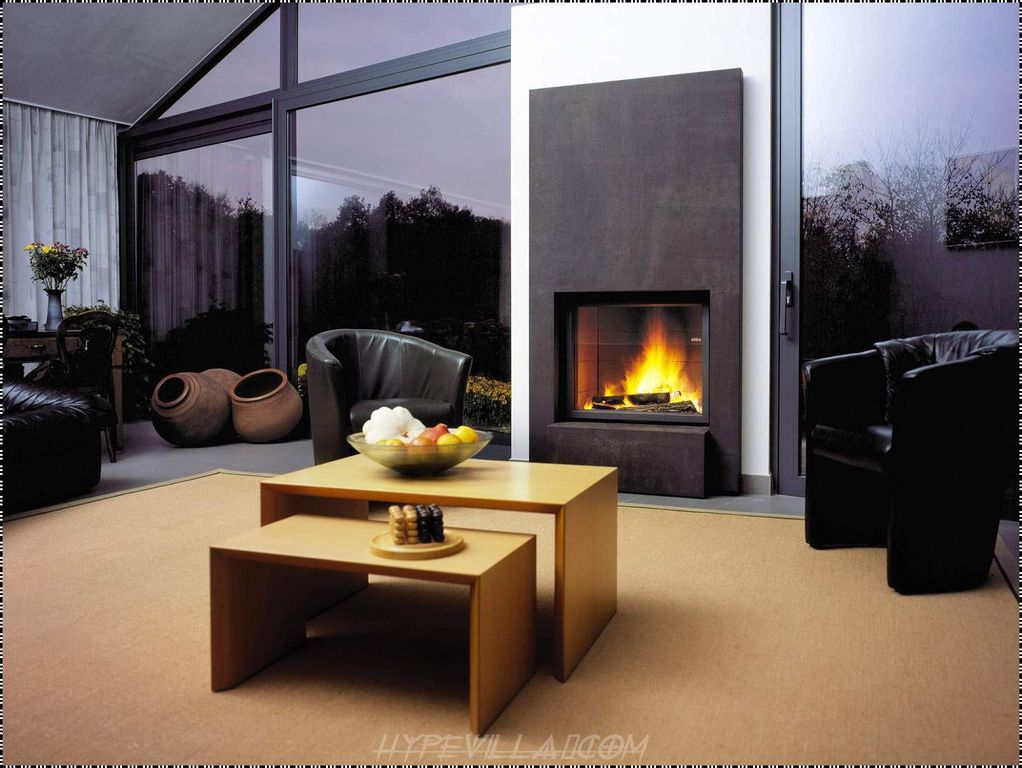 contemporary living room with cathedral ceiling & cement fireplace