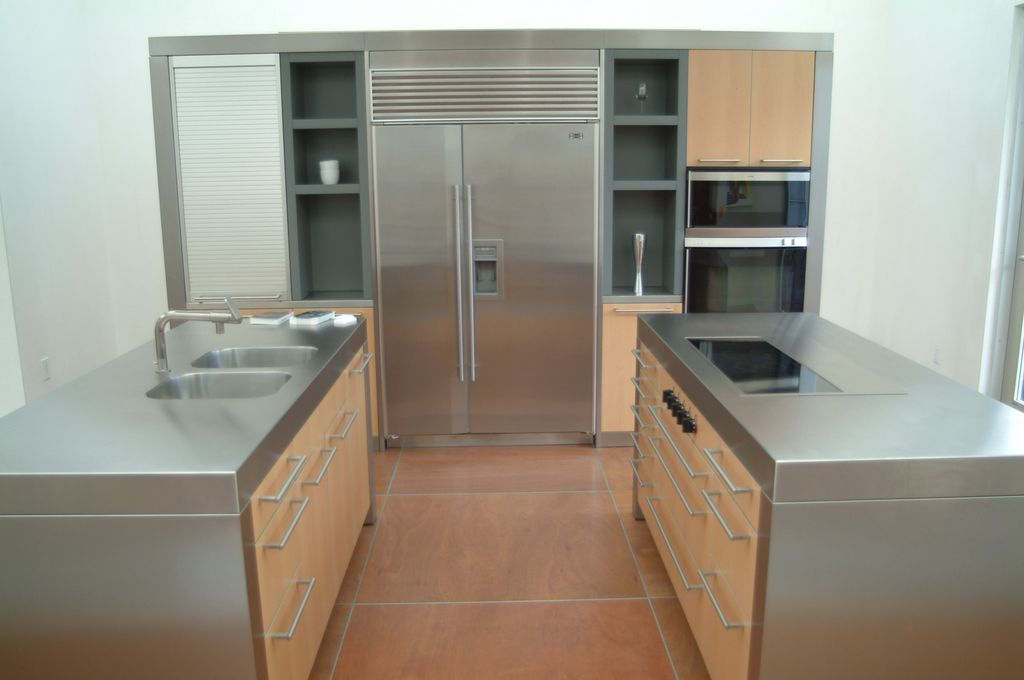 Contemporary kitchen with stainless steel counters by for Bulthaup kitchen cabinets