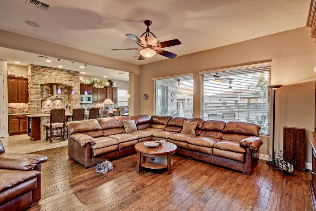 traditional living room with high ceiling & hardwood floors in