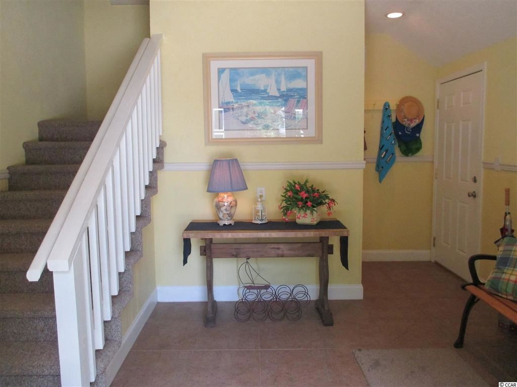 traditional entryway with chair rail & travertine tile floors in