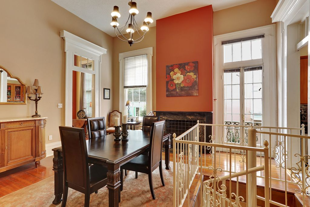 Traditional Dining Room With Hardwood Floors Carpet High Ceiling Chandelier Stone Fireplace