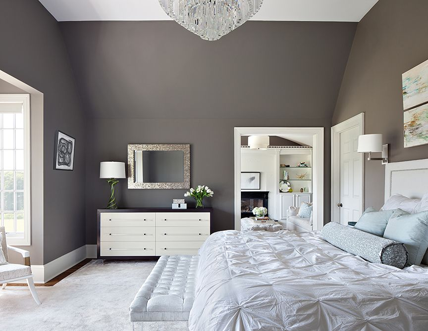 contemporary master bedroom with wall sconceclaire