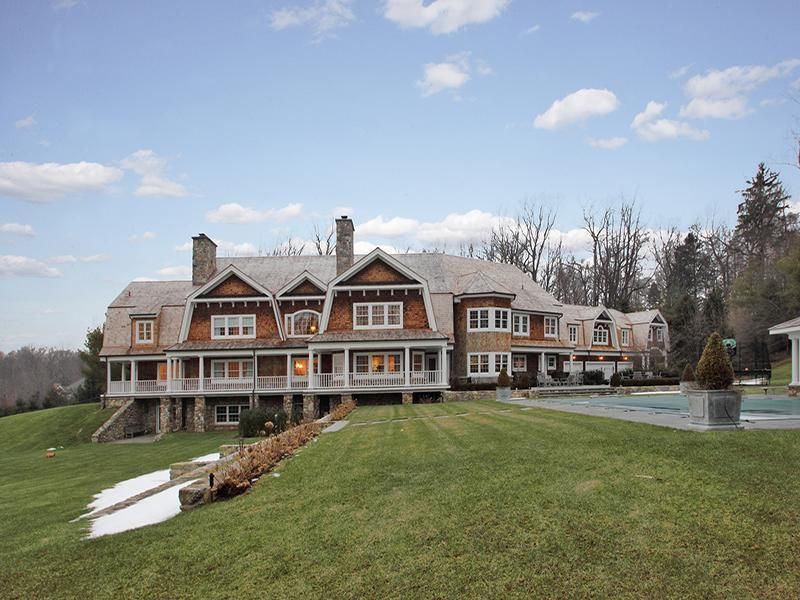 Craftsman exterior of home with outdoor pool exterior for River rock columns