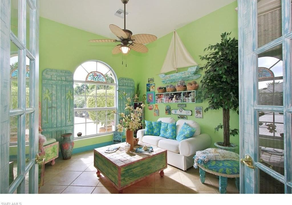 Superb Tropical Living Room With Ceiling Fan, Flush Light, High Ceiling, Limestone  Tile Floors