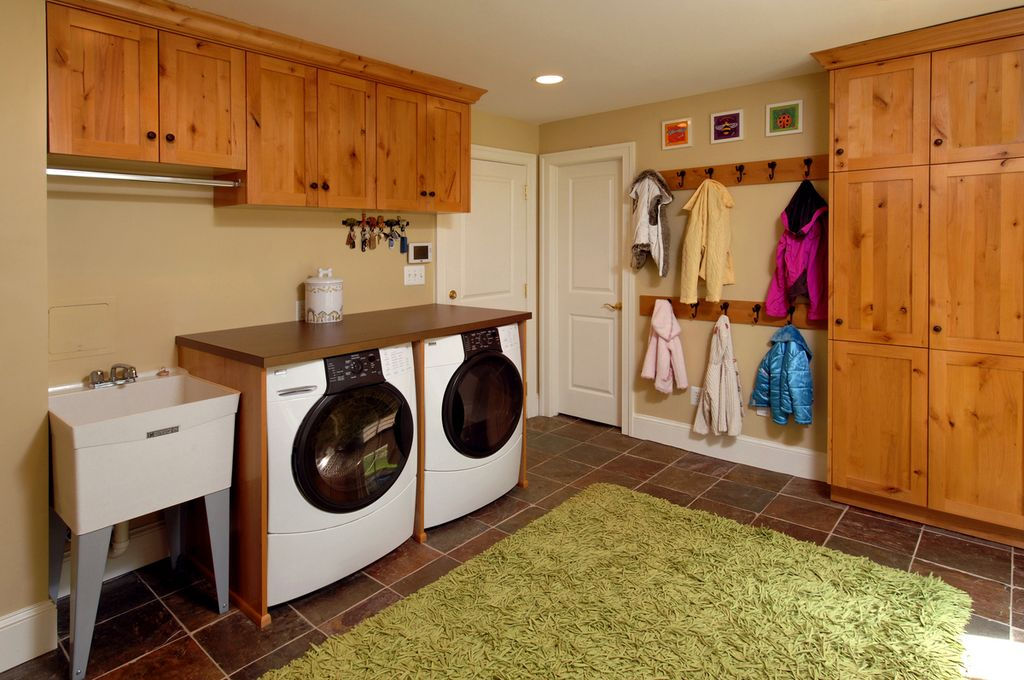 Country Laundry Room With Travertine Tile Floors, Specialty Door, Farmhouse  Sink, Chandra Celecot