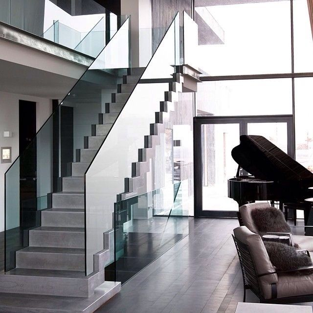 Modern Staircase with Concrete floors, High ceiling, Glass staircase