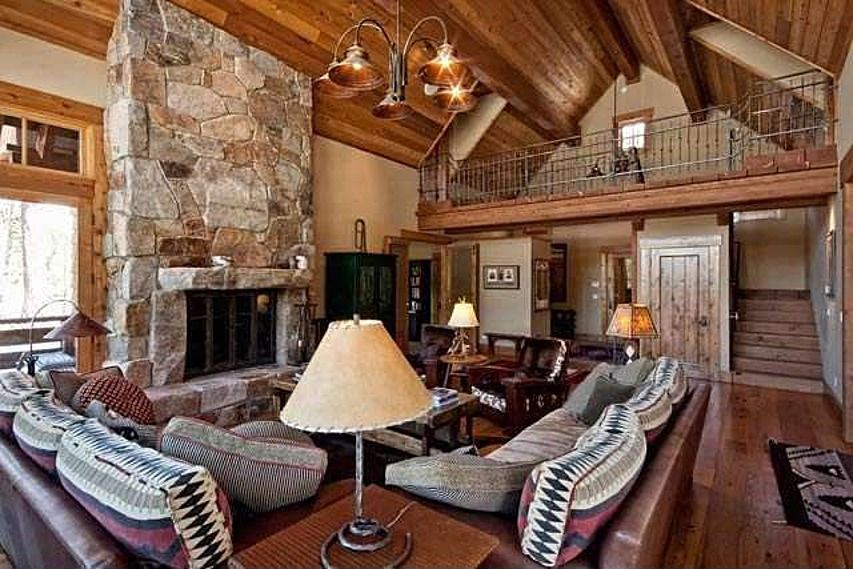 Rustic Great Room With Exposed Beam Amp Stone Fireplace