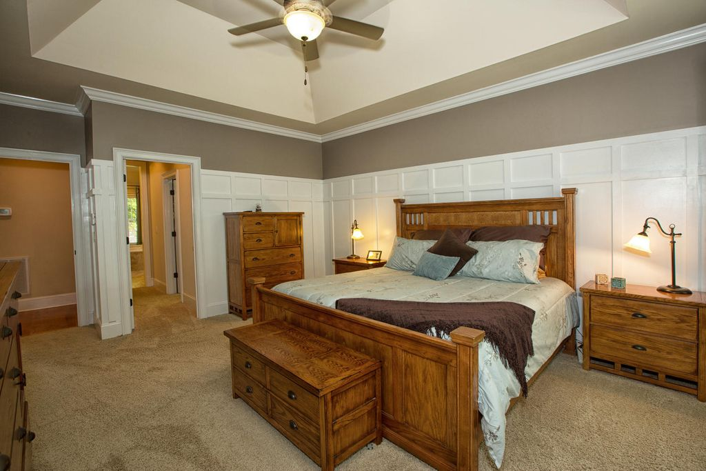 craftsman master bedroom with wainscoting crown molding high ceiling