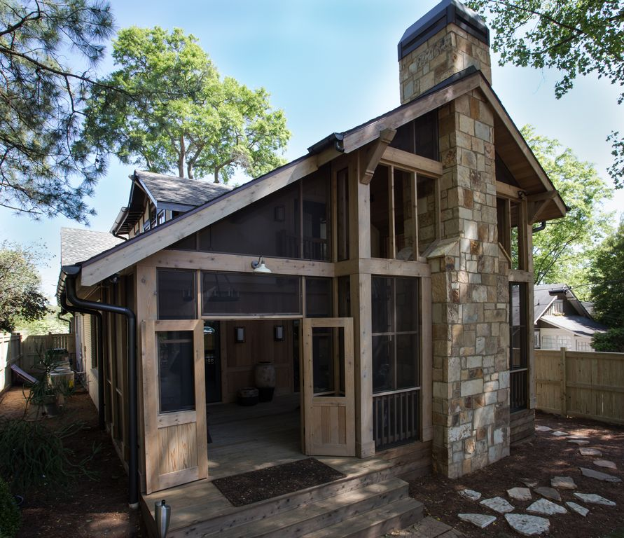 Rustic Exterior Of Home With Exterior Stone Floors By