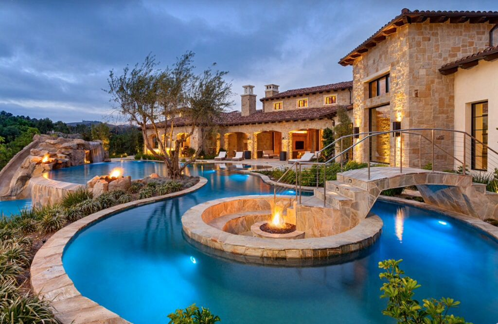 Mediterranean Swimming Pool with Raised beds & exterior stone ...